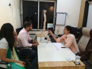 Dr Nivedita Page Providing Consultation for Back Pain